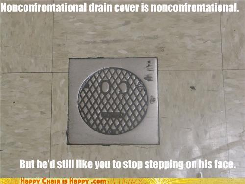 Objects With Faces-Nonconfrontational Drain Cover is Nonconfrontational