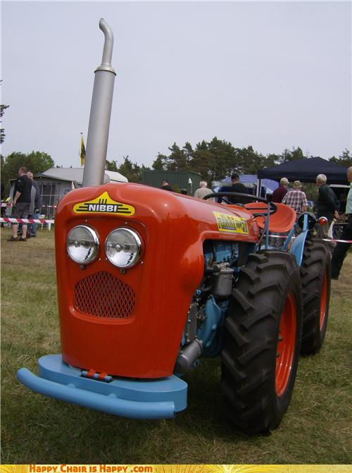 Objects With Faces-Surprised Tractor Thinks That Manure Smells AWFUL